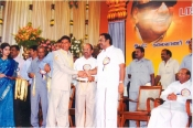 Thiru.Krishnamurthy, Principal, Kongu Mat.Hr.Sec.School, Uthukuzhi, Erode District is receving   State Government award for the Year 2009 from Honourable Minister for Education Thiru.Thangam Thennarasu.